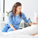 Medical worker with senior woman in nursing home