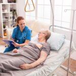 Senior woman lying in nursing home bed