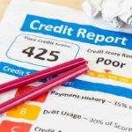 Poor credit score report on wrinkled paper with pen and calculat